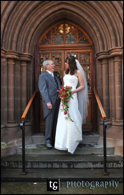 Jennifer and her dad having a laugh at the door of the Troon Old Parish Church