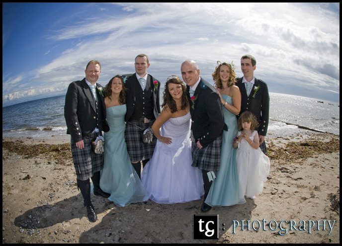 Wedding Kildonan Hotel, Isle of Arran, bridal party wedding photograph on the beach