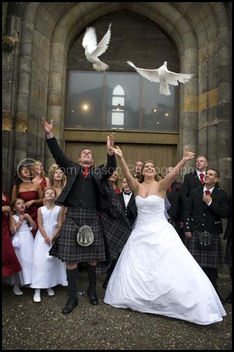 Wedding Scotland, Kilwinning Abbey wedding photograph bride and groom releasing doves