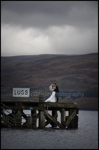 Stunning wedding photograph Luss Pier, Kelly and Kevin