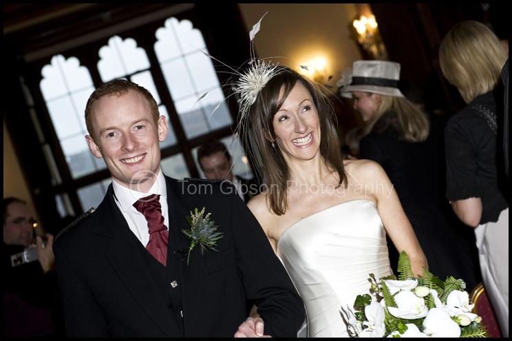 Wedding Mar Hall, Fun wedding photograph Heather and Gavin walking up the aisle