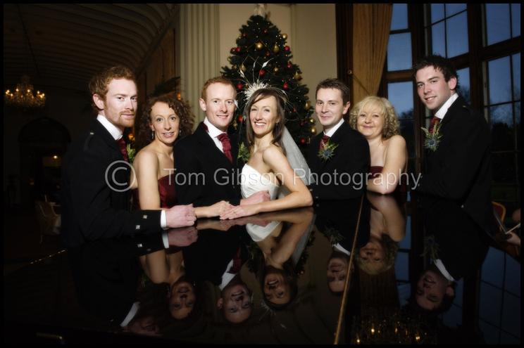 Wedding Mar Hall, Fun wedding photographs, bridal party round piano