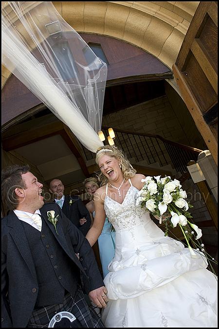 Wedding Troon, fun wedding photograph Jamie€™s viel blowing in the wind