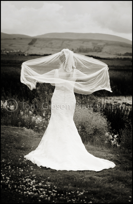 Stunning wedding photograph of bride Laura, wedding lochside house hotel