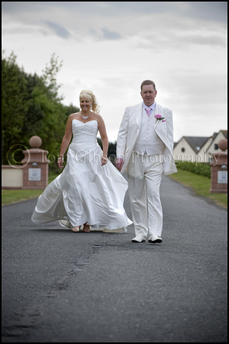 James Bond themed wedding, bride and groom fun wedding photograph