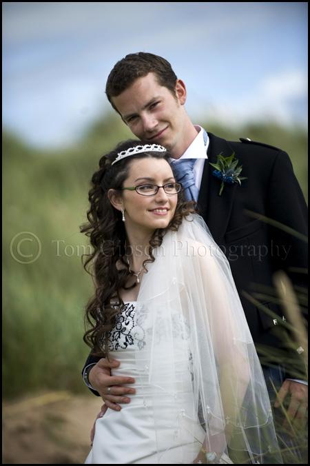 Wedding Photographer Ayrshire Gailes Hotel, bride and groom on the beach wedding photograph