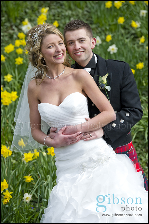 Glenskirlie Castle Wedding Photographer photograph of the Bride and Groom in the flowers