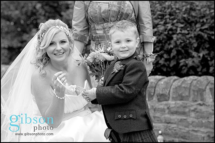 horseshoe photograph Lochside Wedding bride and little boy