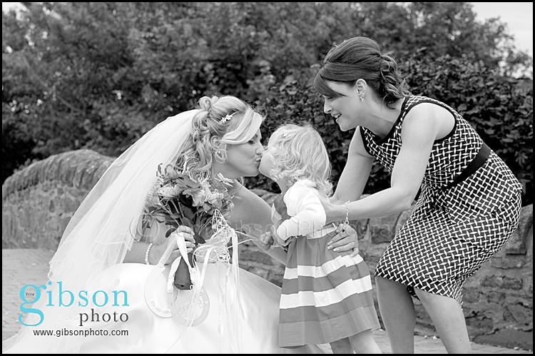 Lochside Wedding Ayrshire bride kissing little girl horseshoe photograph